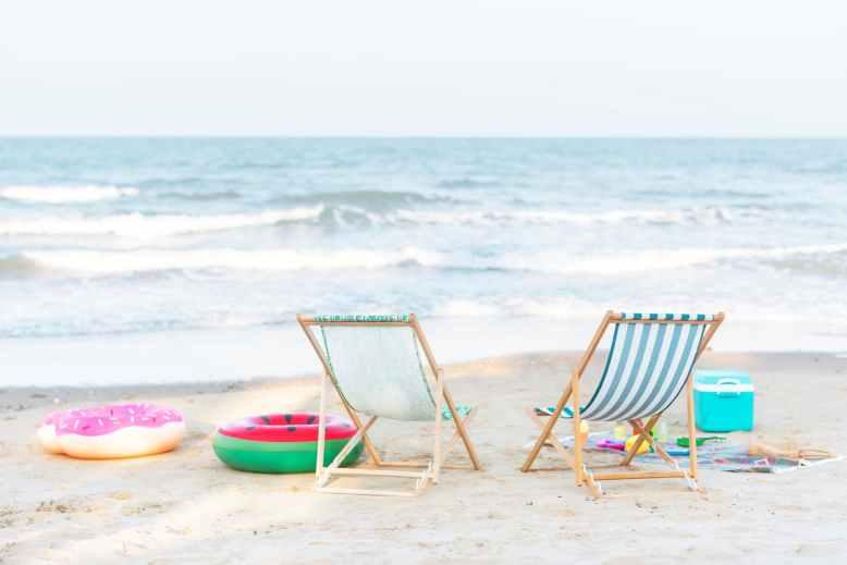 photo of beach chairs on seashore